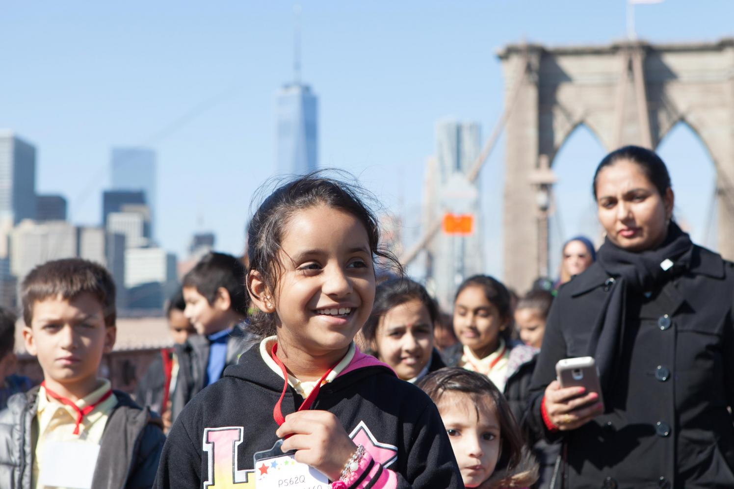 Close up of school children on the Brooklyn Bridge on a sunny day.